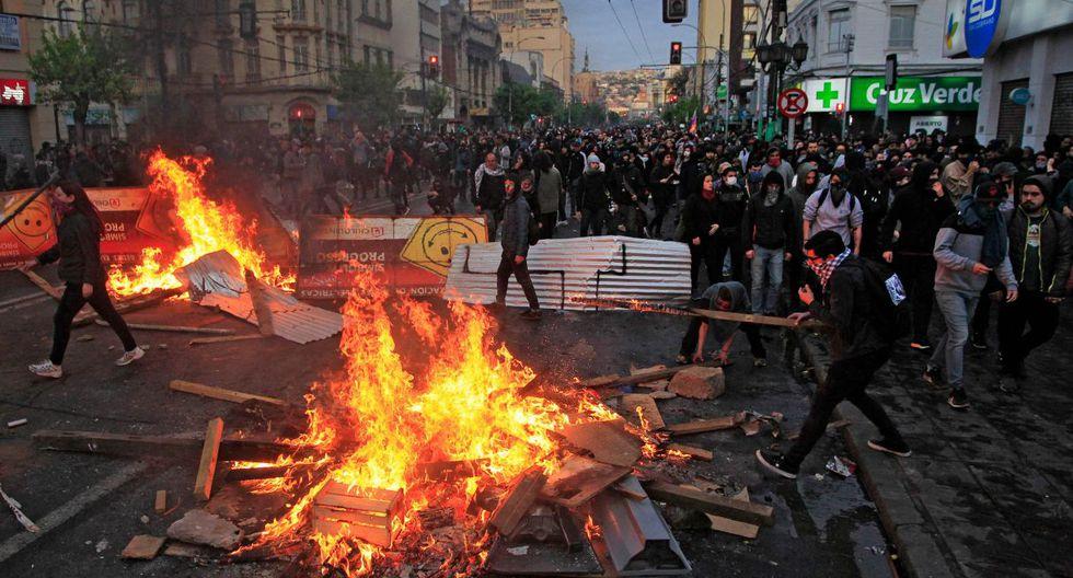"""""""Y va a caer, va caer, Piñera va a caer"""", entonaban un conocido cántico en Chile de la época de la dictadura. (Foto: AFP)"""