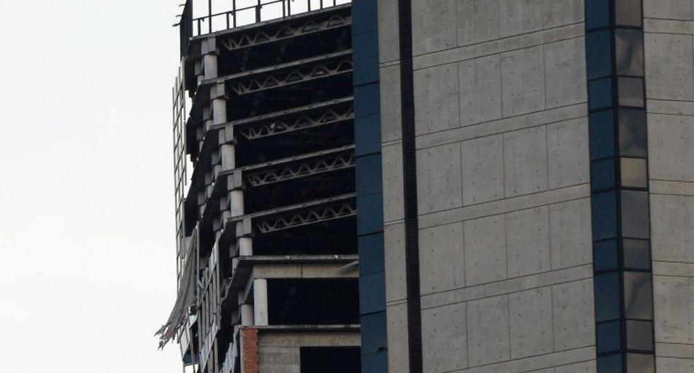 Esta estructura abandonada, conocida como la torre de David, estuvo habitada hasta hace años ilegalmente por familias que fueron desalojadas por el Ejecutivo. (Foto: AFP)