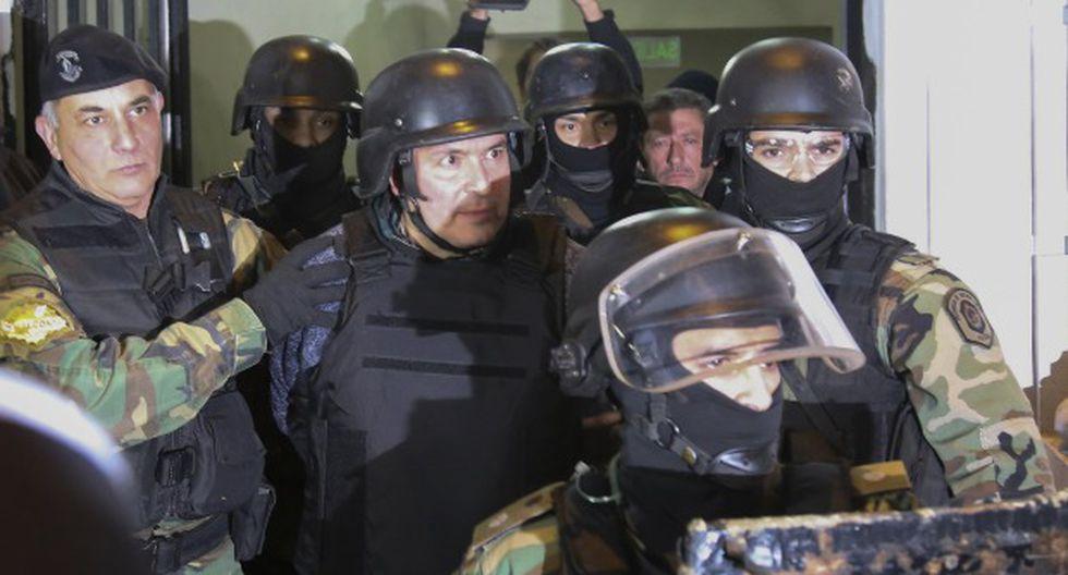 El ex viceministro de Obras Públicas de Argentina José López detenido luego de ser arrestado mientras intentaba ocultar 160 paquetes con más de ocho millones de dólares en un convento, en 2016. (Foto: AFP)