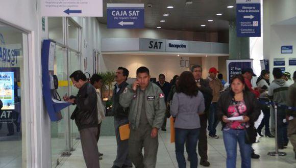 Representantes de personas jurídicas con fotopapeletas ya pagadas deben acudir a la sede central del SAT. (Foto: USI)
