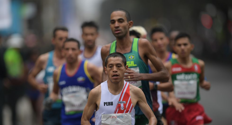 Peru�s Christian Pachecho competes at the men's Marathon during the Pan-American Games Lima 2019 in Lima on July 27, 2019. - The Pan-American Games run until August 11. (Photo by PEDRO PARDO / AFP)