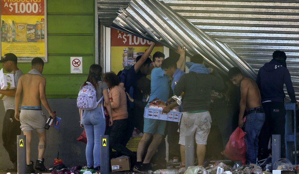 Las violentas protestas en Santiago incluyeron saqueos en centros comerciales. (Foto: AFP)
