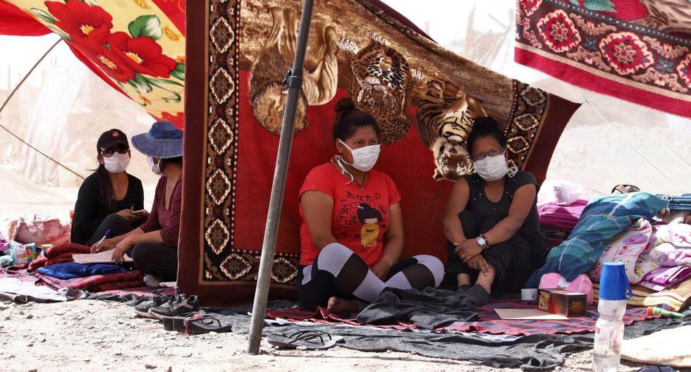Antes del cierre de fronteras, más de 1.000 bolivianos regresaron por tierra al país desde Chile y Brasil, principalmente. (Ignacio MUNOZ / AFP).