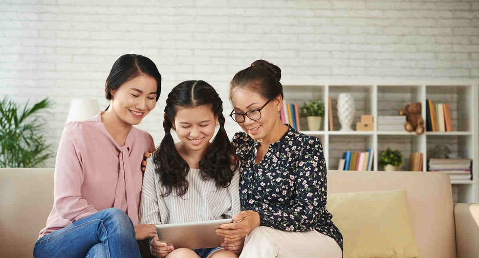 Female generation of family watching videos on tablet computer